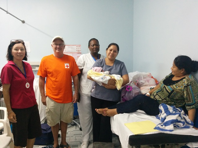 San Pedro Red Cross gave Dinora many bags of goodies thanks to Mom's of Ambergris Caye Group.